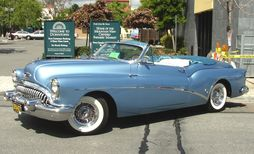 1953 Buick Skylark in side view. Note door dip and chopped top.