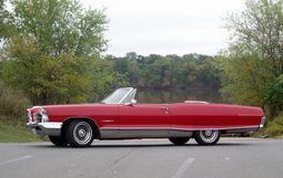 1965 Pontiac Bonneville convertible with 8-lug wheels.